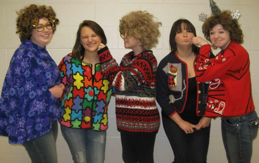 Cosmetology+students+capture+the+holiday+spirit+with+the+ugliest+sweaters+on+campus+last+Friday.++