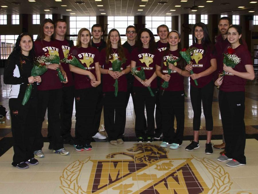 Send off to State in style for Mustang Swimmers. Front row/Left to right: Sr. Hannah Rocksaz,  Jr. Hannah Dooley, Fr. Emily Merner, Jr. Callie Decourt, Jr. Kaitlynn Hartman; Fr. Allie Giles; Fr. Alyssa Dooley; Jr. Mary Kay Jones.   Back row/Left to right: Sr. Dustin Novak; Soph. Chase Seal; Sr. Blake Davis; Sr. Jacob Evans; and Coach Jeremy Wade.
