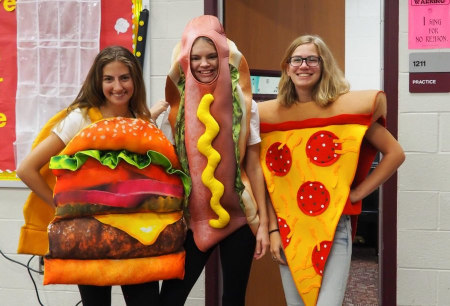 Twin day turned into three day with customs about the foods teens love to eat.  Juniors Audrey Condon, Hanna Beatty, and beam with spirit on Twin day.